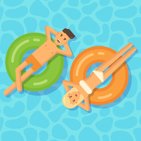 lying in bed: Man and woman floating on inflatable circles in a swimming pool