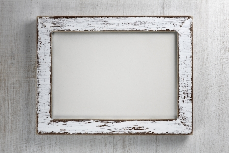 old picture: Vintage wooden frame on wall background Stock Photo