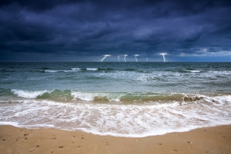 Stormy sky over the sea deserted beach  Bad weather at sea  Off Season photo