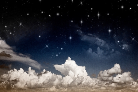 Abstract fantasy night sky with clouds and shining stars textured watercolor paper photo