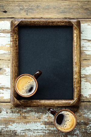 Coffee cups on vintage menu board photo
