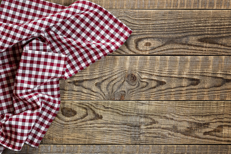 on the tablecloth: Empty wooden table with tablecloth