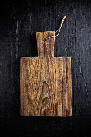 empty table: culinary background with wooden cutting board Stock Photo