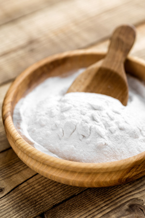 bicarbonate: baking soda in bowl on wooden table