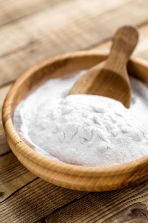 neutralizer: baking soda in bowl on wooden table