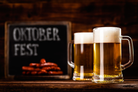 two glass mug of fresh beer as oktoberfest background