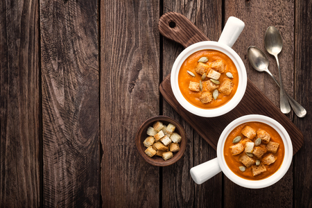 soup bowl: pumpkin soup in bowl on wooden table Stock Photo