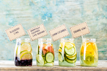 Variety of fruit infused detox water in jars for a healthy diet