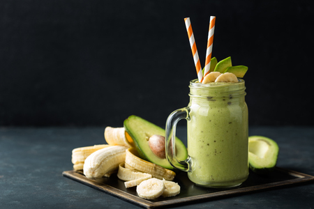 Fresh blended Banana and avocado smoothie with yogurt or milk in mason jar, healthy eating, superfood