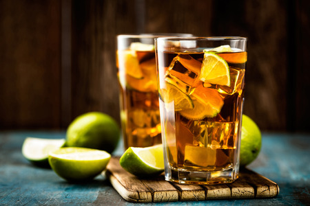 Cuba Libre or long island iced tea cocktail with strong drinks, cola, lime and ice in glass, cold longdrink Stock Photo