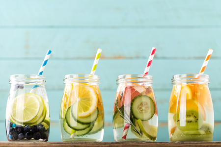 Variety of fruit infused detox water in jars for a healthy diet eating Archivio Fotografico