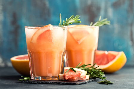Grapefruit and rosemary gin cocktail or margarita, refreshing drink with ice Stock Photo