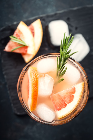 Grapefruit and rosemary gin cocktail or margarita, refreshing drink with ice 写真素材