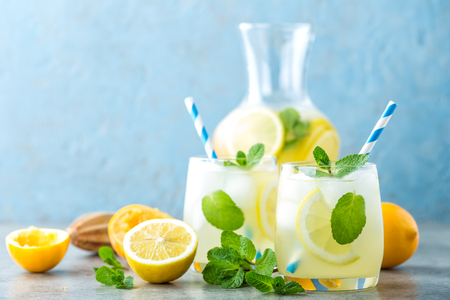 Lemonade or mojito cocktail with lemon and mint, cold refreshing drink or beverage with ice Banco de Imagens