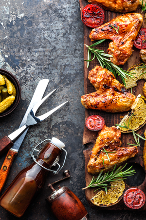 appetizing chicken wings grilled barbecue with spices and vegetables until crispappetizing chicken wings grilled barbecue with spices and vegetables until crisp, top view, space for text