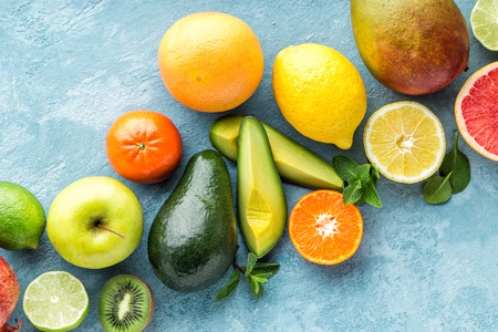 Top view of different selected juicy organic tropical fruits, super food, healthy food background
