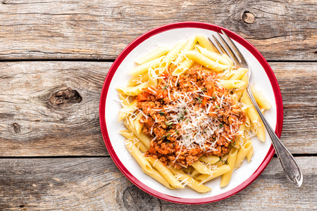 Pasta bolognese. Macaroni served with a classic italian bolognese stew sprinkled with Parmesan cheese Stock Photo