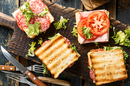 sandwiches with grilled toast ham salami cheese tomatoes and lettuce Reklamní fotografie