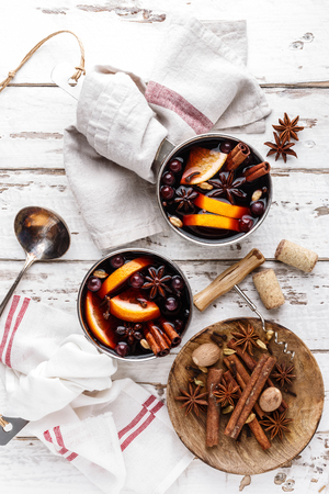 mulled wine winter and autumn warming drink cooked with spices and cranberries Stock Photo - 113696988