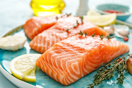 Seafood. Fresh raw salmon or trout fillets with ingredients Reklamní fotografie