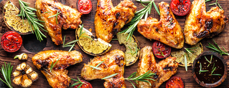 grilled chicken wings with vegetables, barbecue appetizer, banner