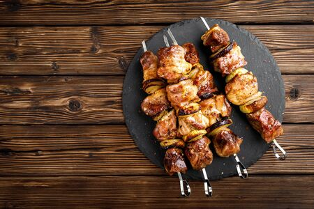 Grilled meat skewers, shish kebab on wooden background, top view Stock Photo