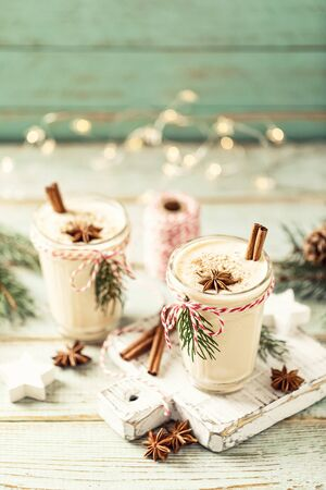 Eggnog. Traditional Christmas drink, spiced egg-milk cocktail with nut topping. Banco de Imagens