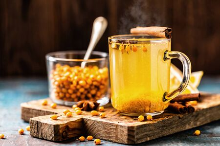 Sea buckthorn tea. Hot healing berry drink for the winter and fall season