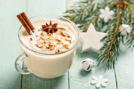 Eggnog. Traditional Christmas drink, spiced egg-milk cocktail with cream caramel topping.