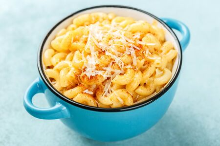 Macaroni and cheese. traditional american dish macaroni pasta and a cheese sauce
