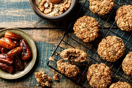 Healthy dessert. Homemade oatmeal cookies with dates and nuts, do not contain sugar, butter and eggs. Stok Fotoğraf