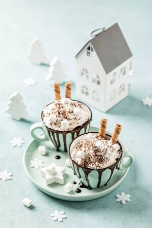 Hot chocolate festive dessert with whipped cream or ice cream
