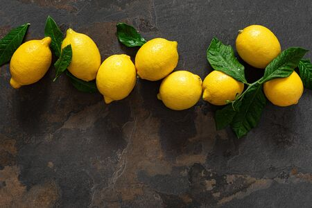 Fresh lemons with leaves, vitamin c concept, top view Stok Fotoğraf