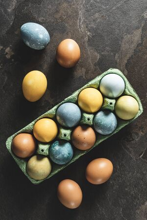 Easter background. Natural dyed easter eggs on dark stone background. Stok Fotoğraf