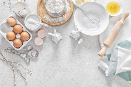 Easter culinary background. Easter food ingredients composition on the kitchen table and space for a text menu or recipe.
