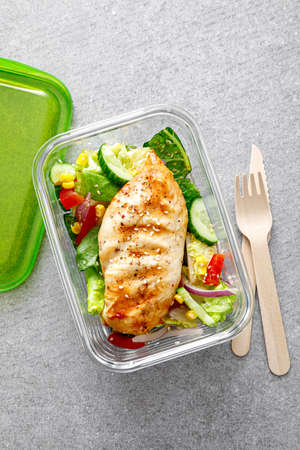 lunch box of vegetable salad with grilled chicken breast