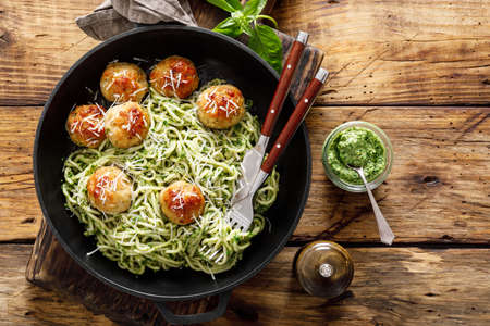 Pasta with meatballs and pesto sauce