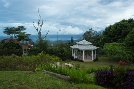 Under construction gazebo on the beautiful garden. Backyard views of Bandungan Hills Hotel and Resort on Semarang, Indonesia.