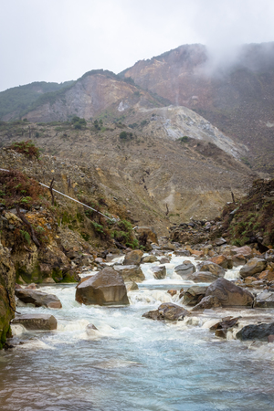 Rocky stream with white water on a mountain. Beautiful landscape of mount Papandayan. Papandayan Mountain is one of the favorite place to hike on Garut. Stok Fotoğraf