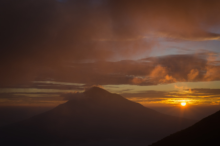 Warm morning sunrise on Tebing Soni with view of mount Cikuray. Beautiful landscape of mount Papandayan. Papandayan Mountain is one of the favorite place to hike on Garut.