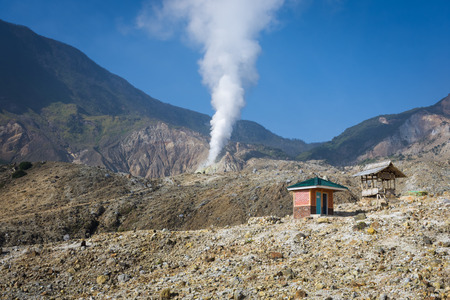 A landscape of rocky track on mount Papandayan that challenging for the hiker. Restroom and post on mountain track. The most active volcano on Garut. Stockfoto