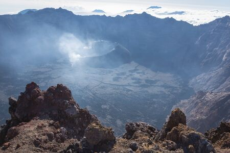 A view from Puncak Sejati (3,344m) and its Caldera. Raung is the most challenging of all Java's mountain trails, also is one of the most active volcanoes on the island of Java in Indonesia.