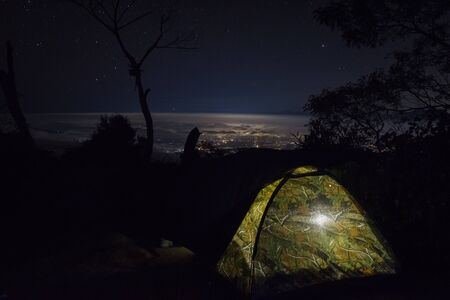 A beautiful night city view from campsite 7 mount Raung. Raung is the most challenging of all Java's mountain trails, also is one of the most active volcanoes on the island of Java in Indonesia.