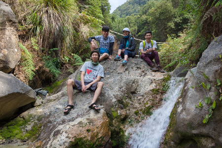 Garut, Indonesia - August 12, 2018 : A group of young people are enjoying and hiking Papandayan Mountain. Papandayan Mountain is one of the favorite place to hike on Garut.