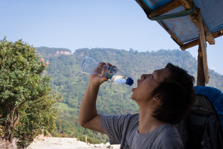 Garut, Indonesia - August 12, 2018 : A man are enjoying and hiking Papandayan Mountain. Papandayan Mountain is one of the favorite place to hike on Garut.