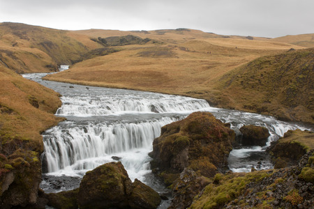 skogafoss waterfall: rapids come through a canyon before skogafoss waterfall Stock Photo
