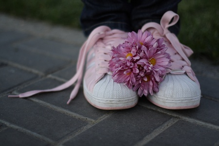 Pink gym shoes and pink bouquet