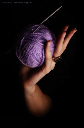 Ball of threads in a hand Stock Photo