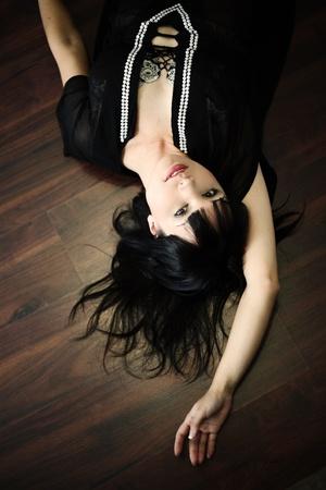Portrait of beautiful sexy woman on floor
