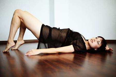 beautiful sexy woman on floor Stock Photo